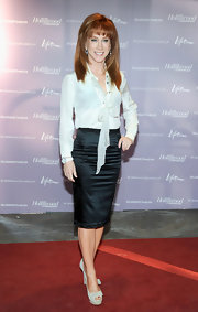 Kathy Griffin gave the secretarial look a go at the 'Women in Entertainment Breakfast' in a sheer white tie-neck blouse tucked into a black satin pencil skirt.