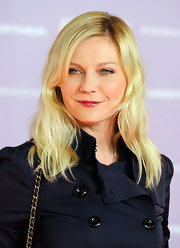 Kirsten Dunst wore her pale tresses in barely-there waves with side-swept bangs at the Women in Entertainment breakfast.