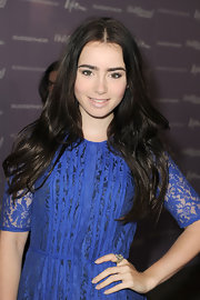 Raven-haired beauty Lily Collins wore her shiny tresses in soft, flowing waves at the Women in Entertainment breakfast.