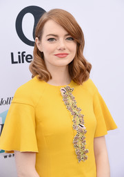 Emma Stone looked oh-so-sweet with her flawlessly styled curls at the Hollywood Reporter's Women in Entertainment Breakfast.