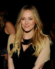 Hilary Duff center parted her hair and wore soft waves to create this spectacular look.