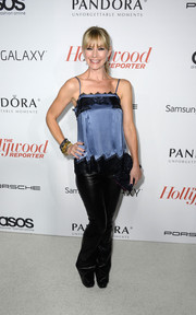 Meredith Monroe paired a lace-embellished blue and black camisole with leather pants for a sweet-edgy look during the Hollywood Reporter Emmy party.