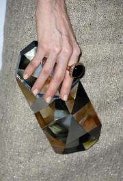 Darby Stanchfield carried a very elegant geometric-shaped mother-of-pearl clutch when she attended the Hollywood Reporter Emmy party.