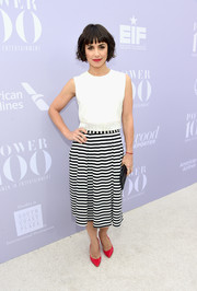Constance Zimmer splashed some color into her monochrome outfit with a pair of bright red pumps.