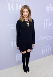 Ashley Tisdale kept it relaxed in a black tie-neck shift dress at the Women in Entertainment Breakfast.