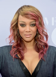 Tyra Banks sported cool ombre curls at the Women in Entertainment Breakfast.