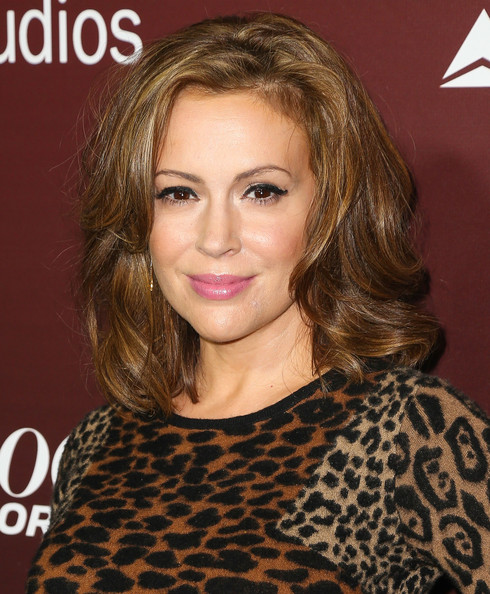 Alyssa Milano looked as hot as ever with this sexy wavy 'do and animal-print shirt combo at the Next Gen 20th anniversary gala.