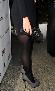 The leather clutch with rose detail adds texture to Kate's entire look while complementing the detail on her dress.