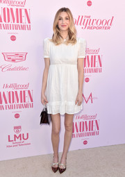 A pair of printed pumps with bedazzled bow detailing finished off Whitney Port's ensemble.