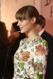 Bella Heathcote tied her locks in a tiny elegant bun at the Hollywood Reporter event.