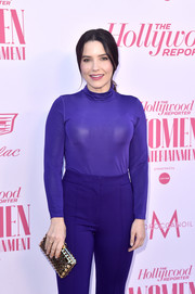 Sophia Bush accessorized with a gold lattice clutch for a dose of shine to her purple outfit at the Hollywood Reporter's Power 100 Women in Entertainment celebration.