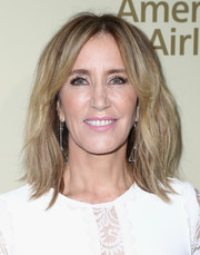 Felicity Huffman wore her hair in teased layers at the Hollywood Reporter and SAG-AFTRA Emmy nominees night.