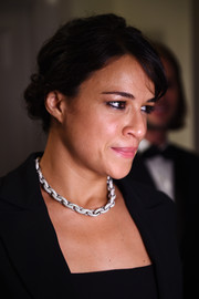 Michelle Rodriguez attended the Hollywood Reporter and Swarovski party wearing her hair in a twisted bun.