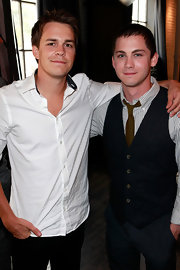 Logan Lerman layered a black tweed vest over his striped button-down for a preppy finish during the 2012 Toronto International Film Festival.