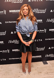 Wendy Williams mixed textures when she sported this denim button down with a leather skirt.