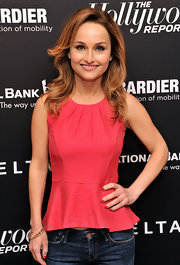 A red peplum top showed off Giada De Laurentiis' tiny waist and toned arms.