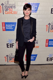A pair of black Viktor & Rolf skinny pants added a hint of sexiness to Anne Hathaway's look.