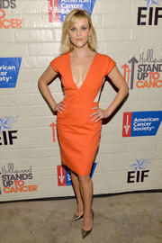 Reese Witherspoon looked alluring in a cleavage-baring orange dress by Roland Mouret during the Hollywood Stands Up to Cancer event.