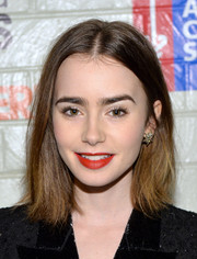 Lily Collins' rich red lipstick looked striking against her pale foundation.