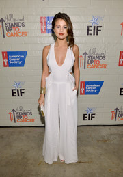 Selena Gomez looked uber cool at the Hollywood Stands Up to Cancer event in a white BCBG Max Azria jumpsuit with side cutouts and a deep plunge.