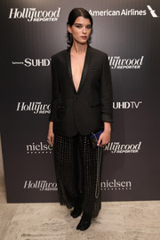 Crystal Renn sealed off her androgynous look with a pair of black grid-patterned wide-leg pants.