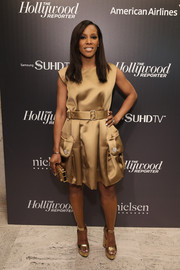 June Ambrose rounded out her shimmery look with a pair of gold Tom Ford platform sandals.