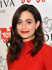 Emmy Rossum polished off her look with a pair of geometric studs.
