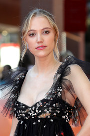 Maika Monroe styled her hair into a bun with wavy tendrils for the Rome Film Fest screening of 'Hot Summer Nights.'