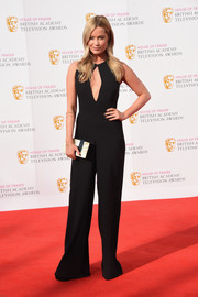 Laura Whitmore styled her simple outfit with a paneled box clutch.