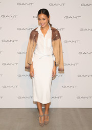 Jamie Chung was classic and stylish in a white Aritzia pencil skirt paired with a tie-waist button-down during the House of Gant presentation.