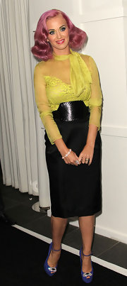 Katy Perry was pretty in yellow in a sheer and fitted blouse paired with a classic black pencil skirt.