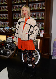 Elisabeth von Thurn und Taxis completed her eye-catching outfit with a pair of hole-y tights.
