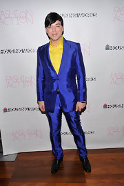 Malan is not afraid to make a bold fashion move! Here is sports an iridescent royal blue suit over a yellow button-up.