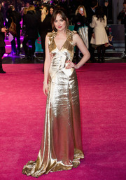 Dakota Johnson went for high shine in a gold Marc Jacobs dress with a floor-sweeping hem and ruffle shoulders during the European premiere of 'How to Be Single.'