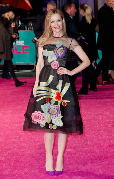 Leslie Mann added an extra pop of color with a pair of purple Louboutins.