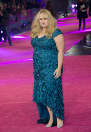 Rebel Wilson dazzled in a richly textured petrol-blue fishtail dress at the European premiere of 'How to Be Single.'