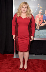 Rebel Wilson flaunted her curves at the New York premiere of 'How to Be Single' in a red Torrid sheath dress with sequined side panels.