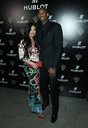 Vanessa Bryant showed off her voluptuous body in a colorful print maxi dress during Hublot's celebration.