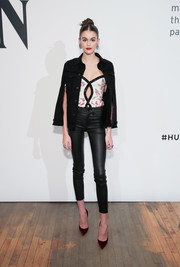 Kaia Gerber topped off her edgy look with a black denim cape, also by Hudson Jeans.