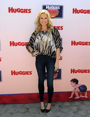 Rebecca Romijn topped off her skinny jeans with a printed sheer blouse.