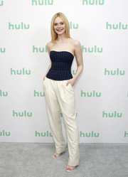 Elle Fanning donned a strapless navy pinstriped top by Ralph Lauren for the 2020 Winter TCA.