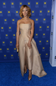 Serayah matched her top with a pair of cropped gold pants, also by Solace London.