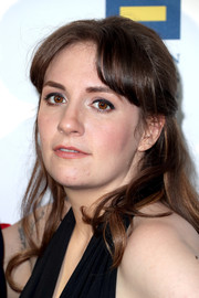 Lena Dunham looked charming wearing this half-up hairstyle with parted bangs at the Human Rights Campaign 2017 Gala.