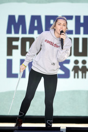 Miley Cyrus teamed her sweater with a pair of heart-motif leggings.