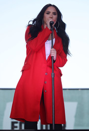Demi Lovato performed at the March for Our Lives rally wearing a bright red wool coat by Alexander McQueen.