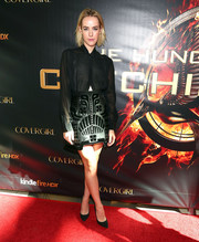 Jena Malone paired her skirt with a sheer black button-down for a totally elegant look.