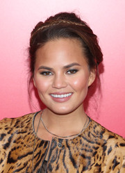 Chrissy Teigen swept her hair up in a romantic crown braid for the 'Catching Fire' NYC premiere.