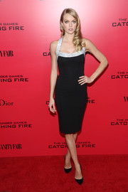 Lindsay Ellingson looked ultra sophisticated in a black cocktail dress with silver shoulder straps during the 'Catching Fire' NYC premiere.