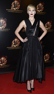 Jennifer Lawrence dared to show some cleavage (both side and front) in a sheer-panel LBD by Christian Dior during the 'Catching Fire' Paris premiere.