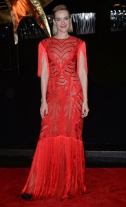 Jena Malone went for '20s glamour in a fringed red Monique Lhuillier gown during the 'Catching Fire' London premiere.